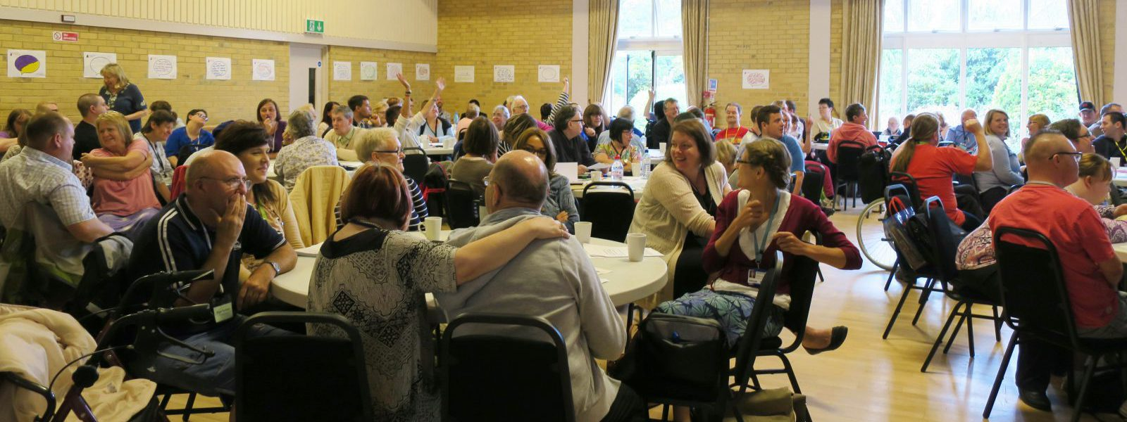 groups round tables at suffolk people first