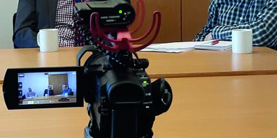 photo of a camera filming an interview