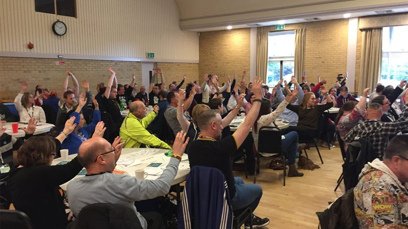crowd with hands raised at suffolk people first