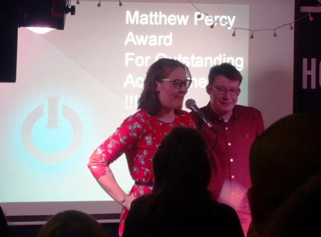 Eva Percy, Matthew Percy's sister, awards Karl Butler with the Matthew Percy Award at IO Radio